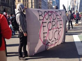 Demonstrators protest 'Operation Fortitude' at Flinders St Station intersection (Catalyst Magazine, 2015)