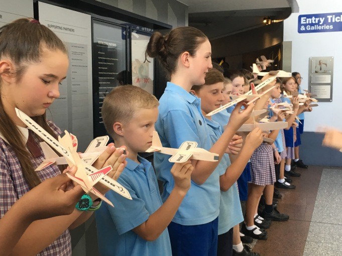 Students from Saint Peter and Paul Primary School get ready to launch balsa wood planes to celebrate opening of 'Above and Beyond' at Questacon