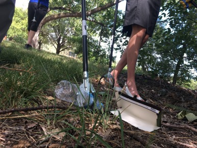 Olympic rower Kim Brennan picks up rubbish on the edge of Lake Burley Griffin (The Canberra Times, 2017)